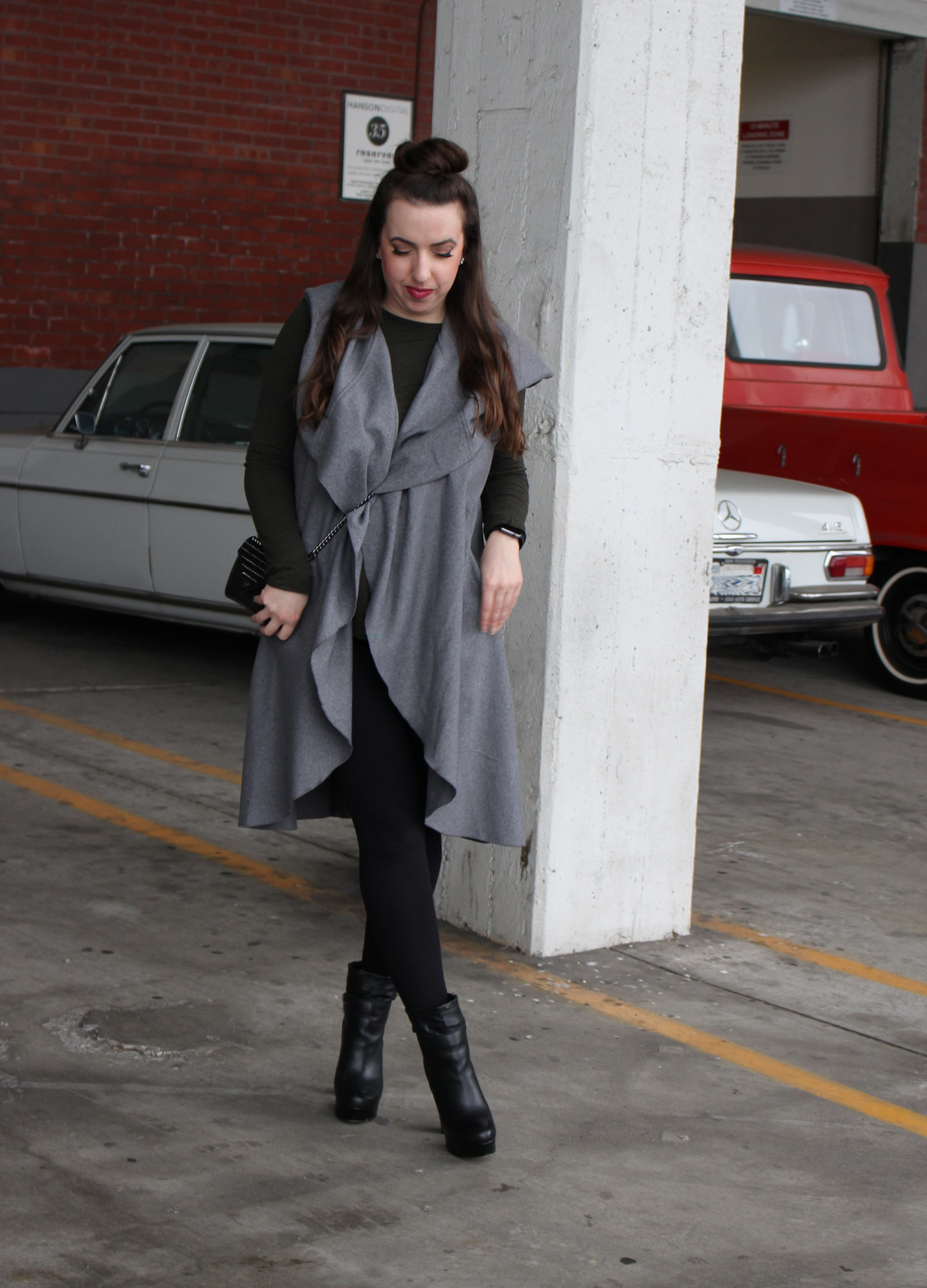 gray sleeveless duster