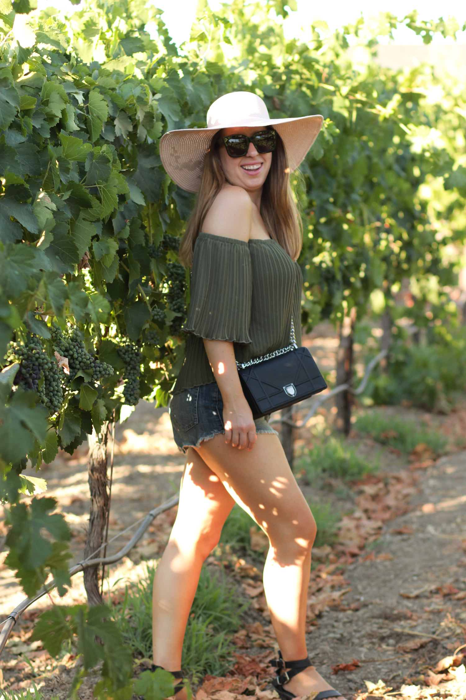 olive bardot top and black dior diorama bag